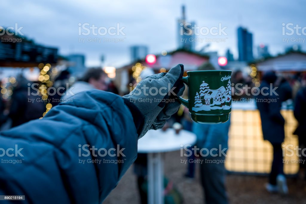 Frankfurt Christmas Market with spiced wine cup and Skyline in background stock photo