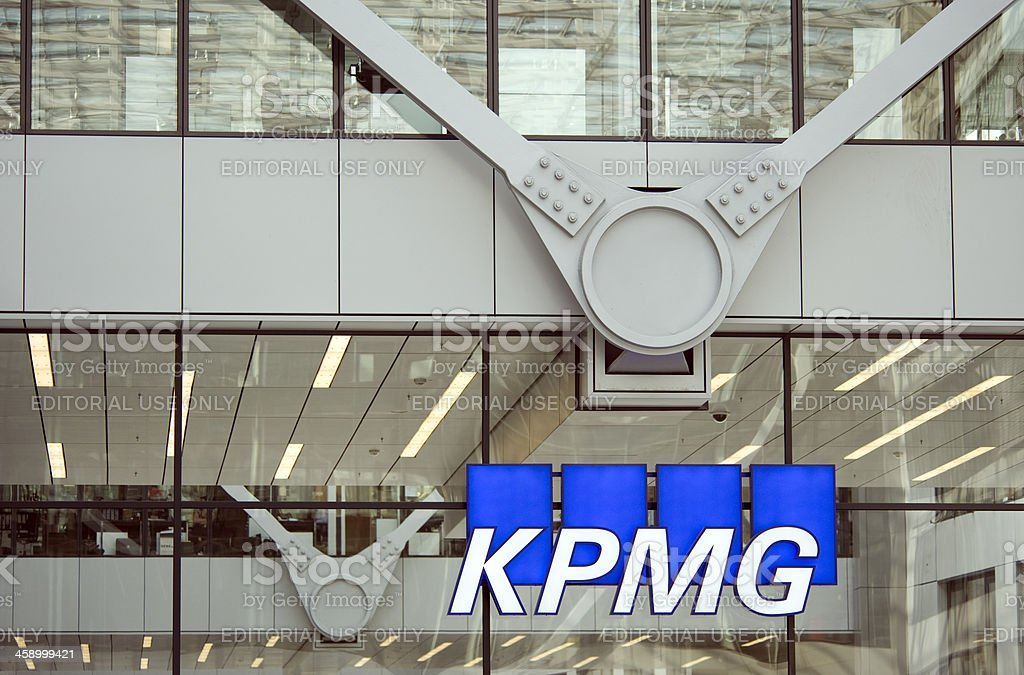 KPMG  Frankfurt, Germany Frankfurt am Main, Germany- March 8, 2012: KPMG Logo at the facade of their office building at the Frankfurt Airport. The company is  heatquartered in Amsteram, The Netherlands. They are one of the largest professional services and accountancy firms in the world. Alphabet Stock Photo