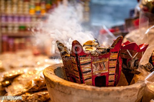 smoking frankincense at the souk in the sultanate of oman.