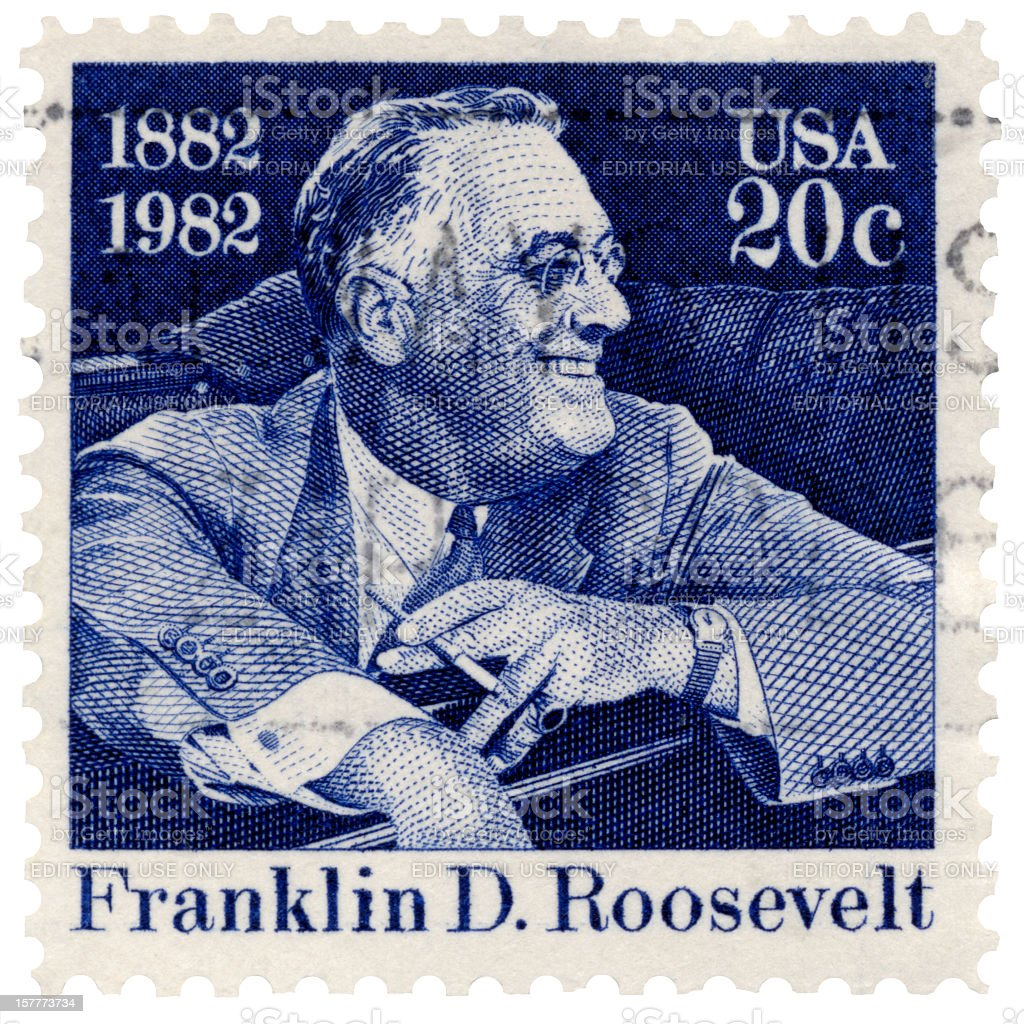 Franklin D. Roosevelt Smiling Seated in Car Postage Stamp stock photo
