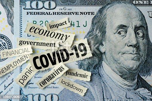 Benjamin Franklin looking COVID-19 newspaper headlines on One Hundred Dollar Bill