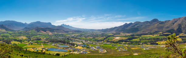 Franschhoek valley panorama with its famous wineries and surrounding mountains stock photo