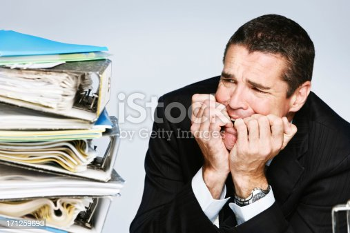 istock Frantic businessman panics at huge quantity of waiting work 171259693