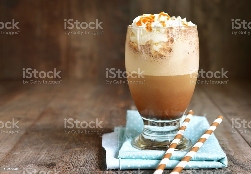 Frappuccino with caramel syrup and whipped cream. stock photo