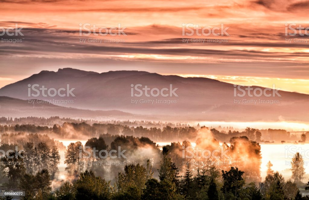 Fraser Valley sunrise in autumn, BC, Canada stock photo
