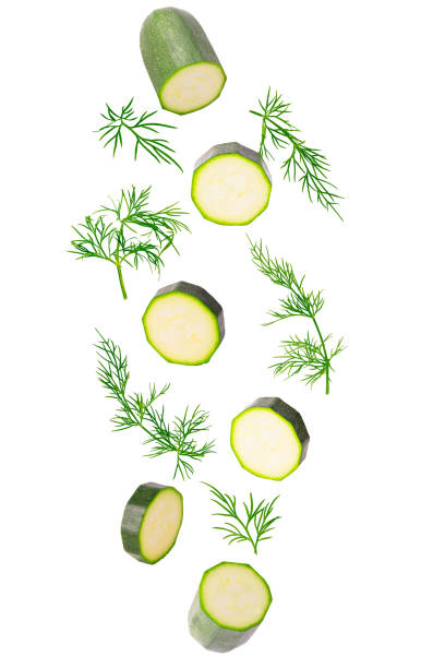 Frash falling zucchini and dill herb isolated on white stock photo