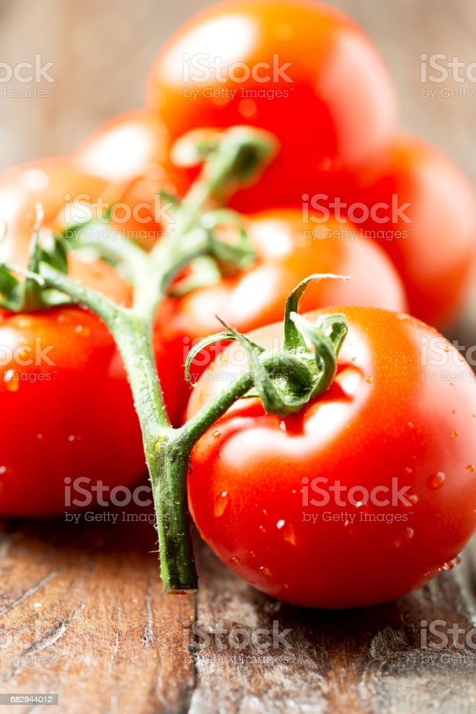 Frash tomatoes on wooden table royalty-free stock photo