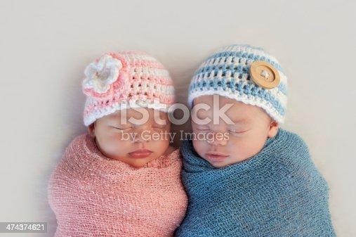 istock Fraternal Twin Baby Brother and Sister 474374621