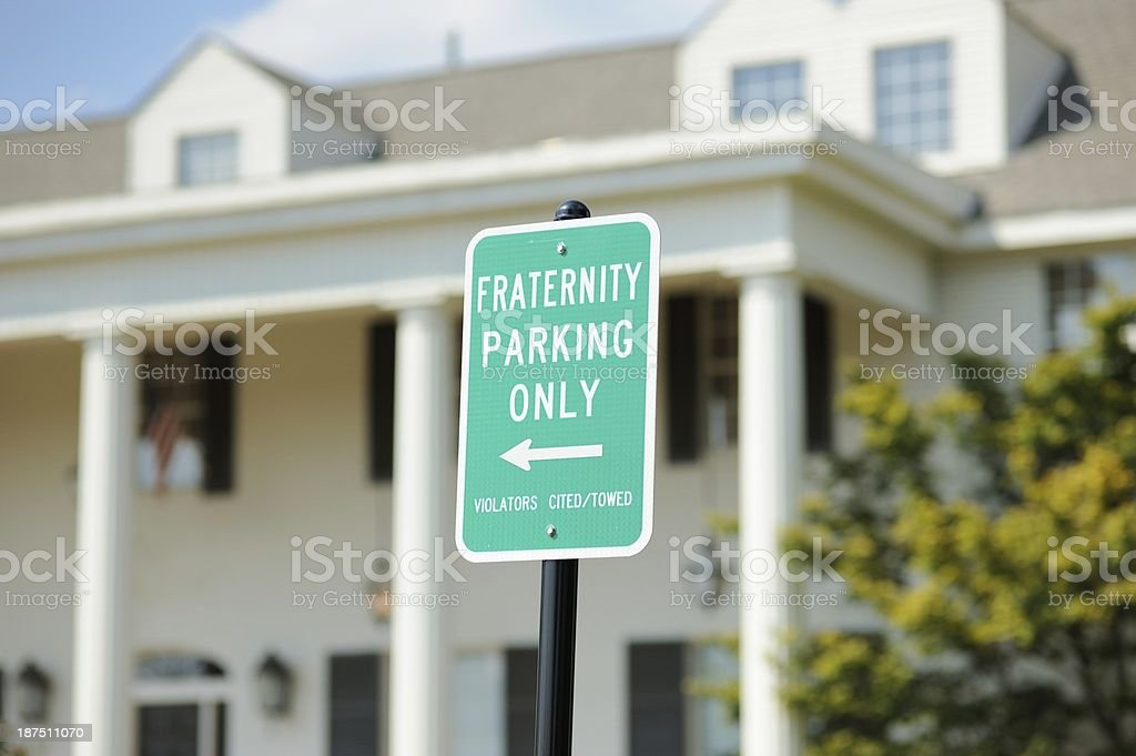 Fraternity house with parking only sign royalty-free stock photo