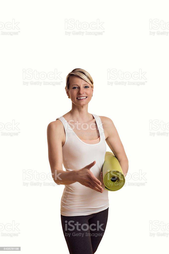 Frau im Yoga Outfit verabschiedet  sich stock photo