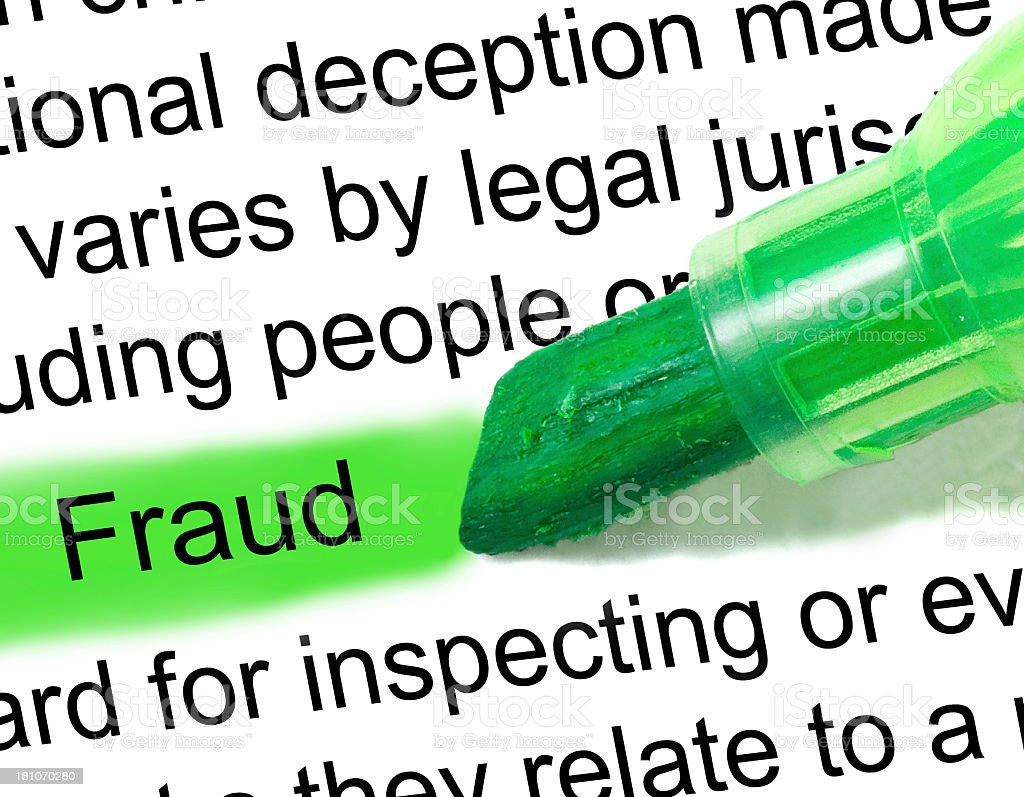 fraud definition highlighted in dictionary stock photo