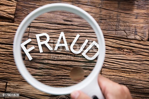 istock Fraud Text Through Magnifying Glass 917901828
