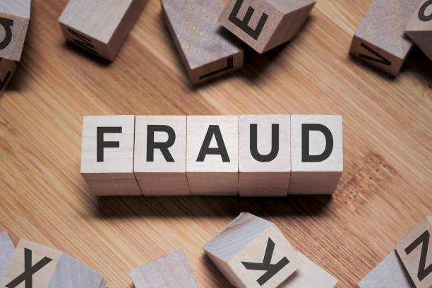 Fraud Word In Wooden Cube stock photo
