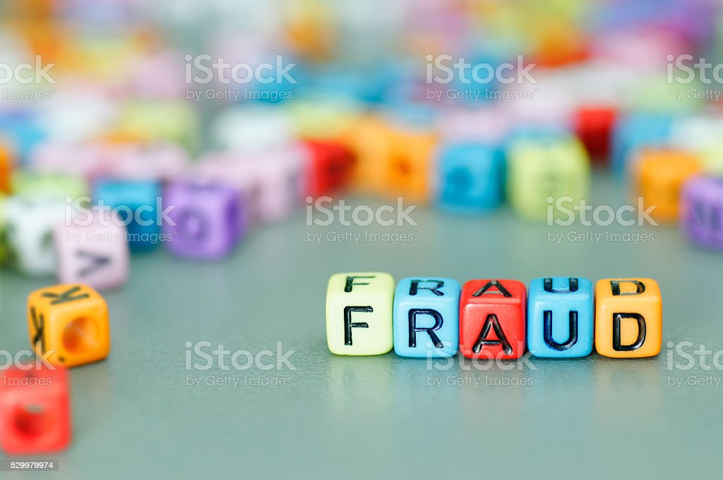 Fraud word on dices stock photo
