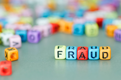 Fraud Word On Dices Stock Photo - Download Image Now