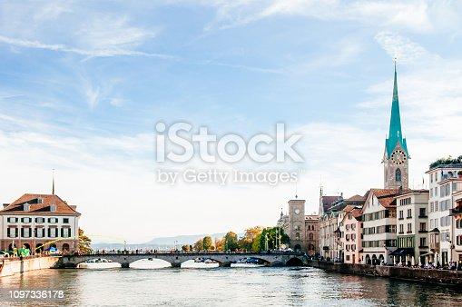 Zurich, Switzerland - Beautiful old medieval Fraumunster Church clock tower and Munsterbrucke bridge Limmat river in Zurich Old town Altstadt