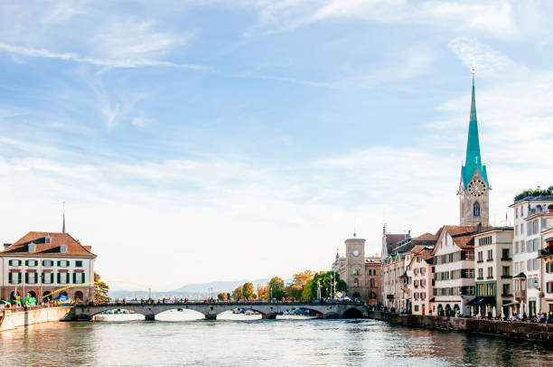 Fraumunster Church and Munsterbrucke bridge Limmat river in Zurich Zurich, Switzerland - Beautiful old medieval Fraumunster Church clock tower and Munsterbrucke bridge Limmat river in Zurich Old town Altstadt fraumunster stock pictures, royalty-free photos & images