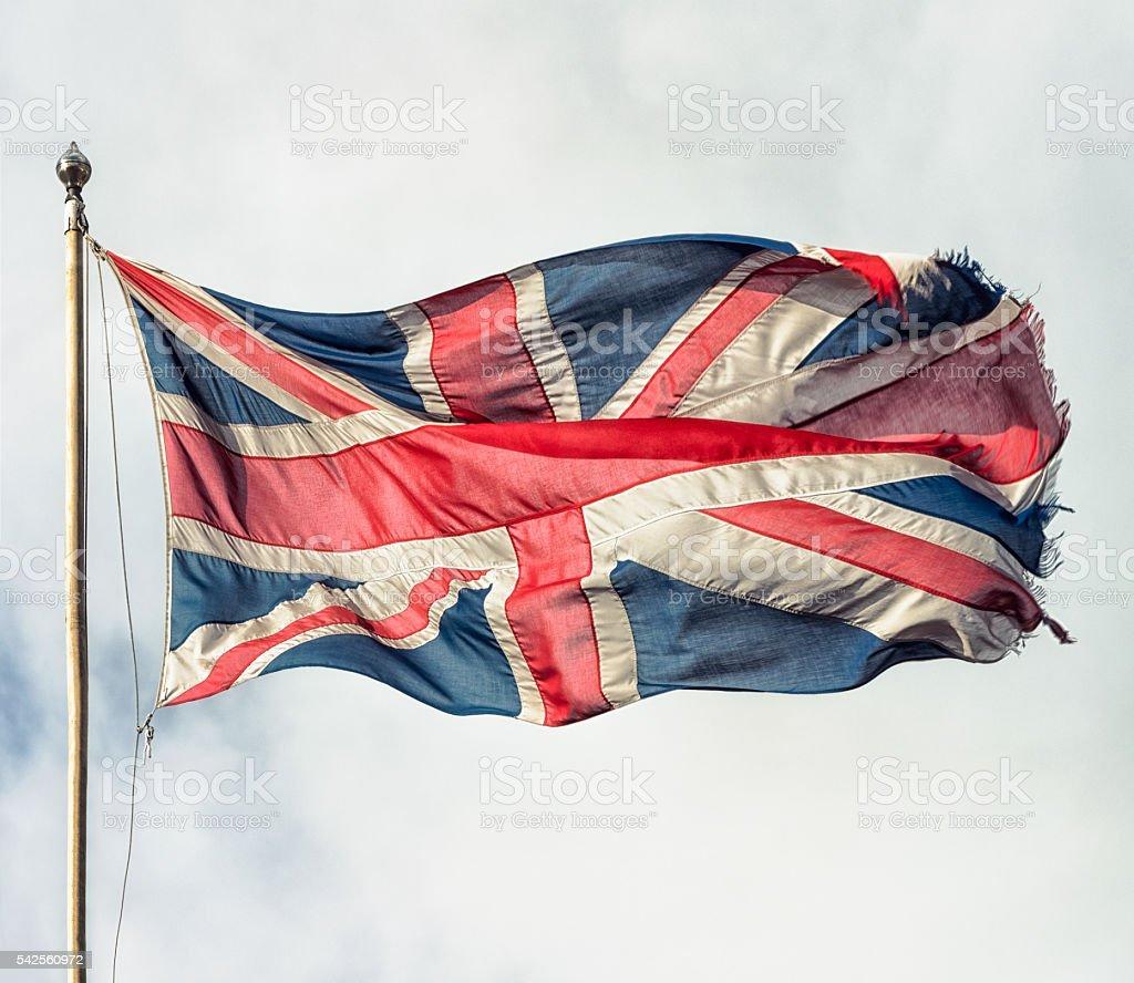 Frayed and faded British union flag stock photo