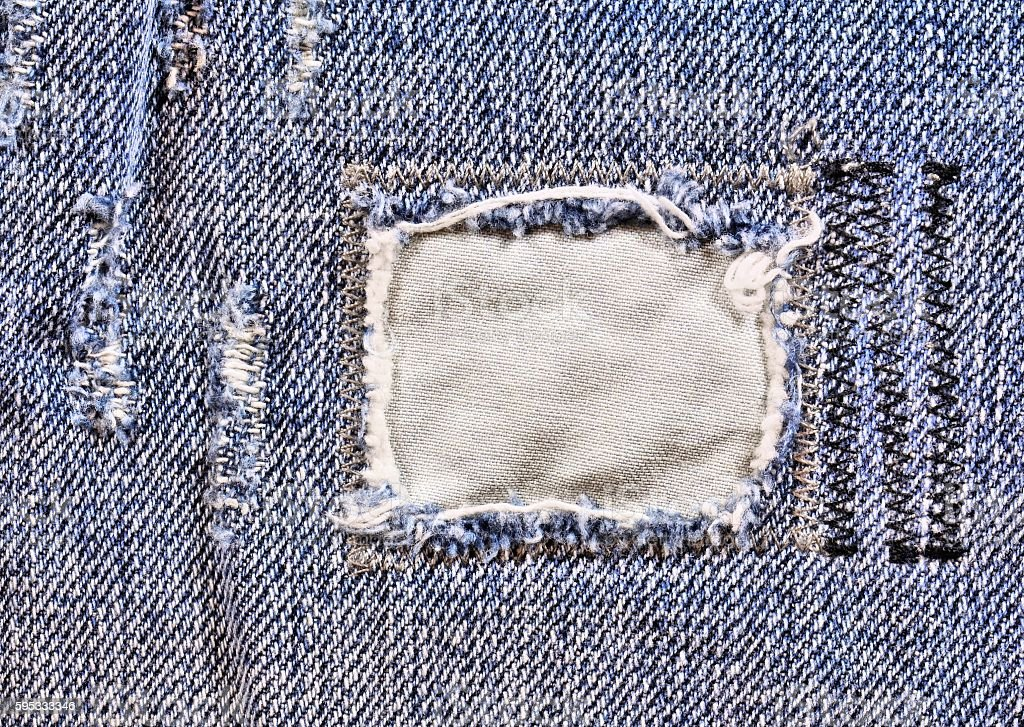 Frayed blue jeans closeup stock photo