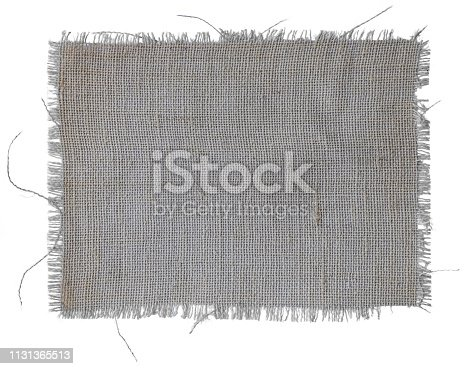 Frayed patch of natural burlap fabric background, isolated on a white background.