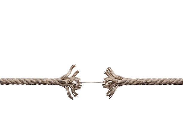Frayed rope about to break stock photo