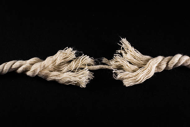 Frayed Rope and Thread on Black Background stock photo
