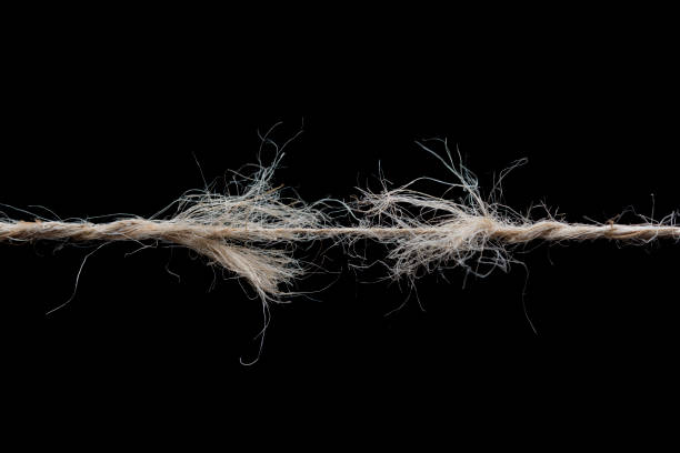 Frayed rope ready to break isolated on black background Frayed rope ready to break isolated on black background snapping stock pictures, royalty-free photos & images