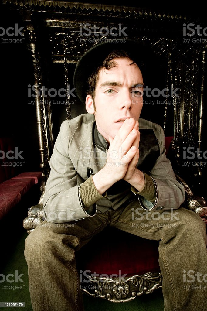 Freaky Guy thinking on the Throne royalty-free stock photo