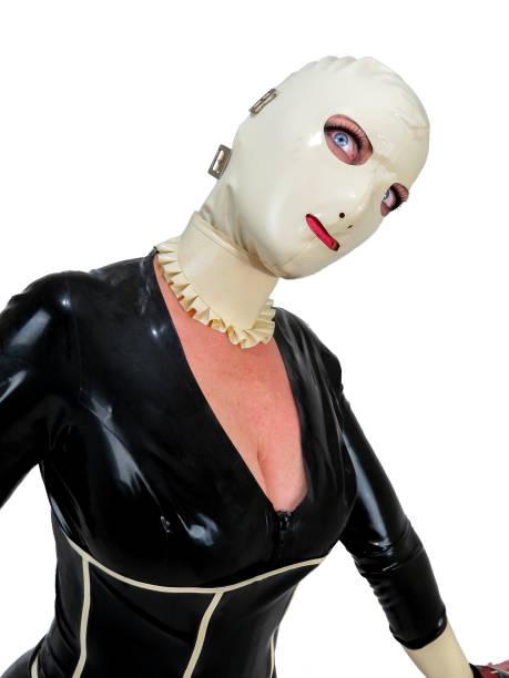 Freaky latex hooded cosplay woman. Creepy big blue eyes. stock photo