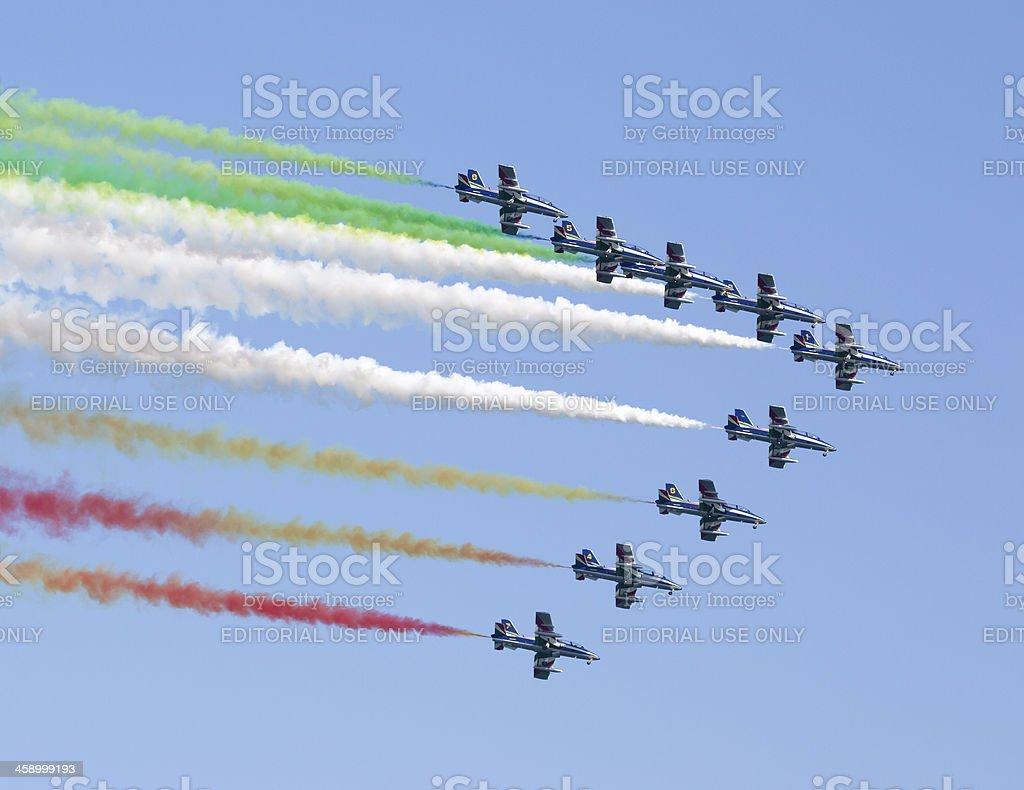 Frecce Tricolori making the Italian flag with smoke, Italy royalty-free stock photo