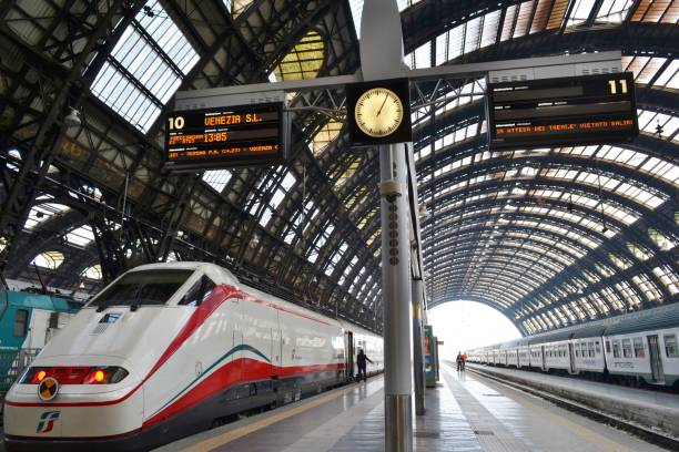 freccia argento - white arrow - high speed train is ready for departure to venice in the milan central railway station. - milan railway foto e immagini stock