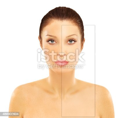 istock Freckles. Model's face divided in two parts. 486902604