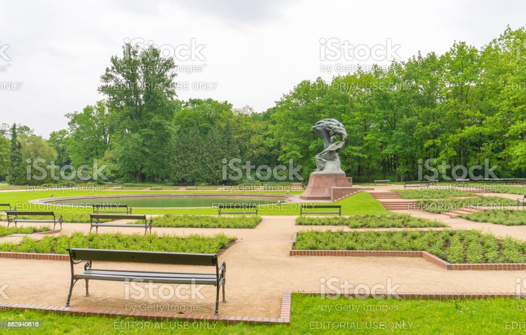 Frederic Chopin statue in Lazienki Park in Warsaw. stock photo