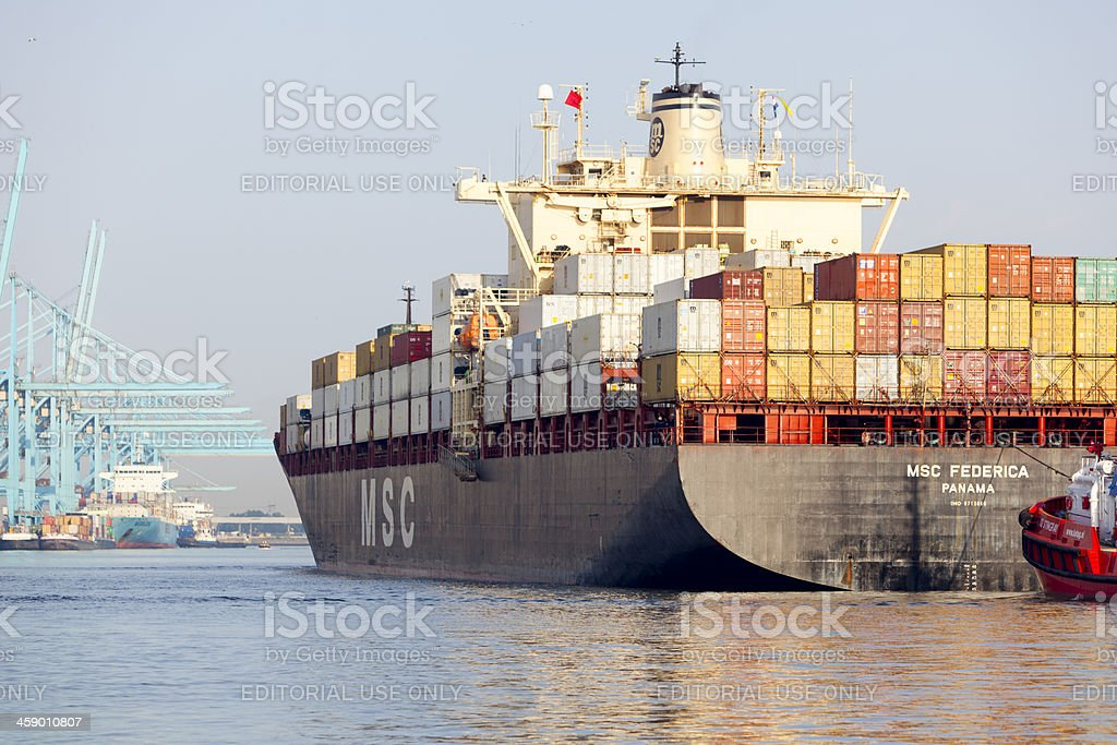 MSC Frederica as it is towed in the Rotterdam harbour stock photo