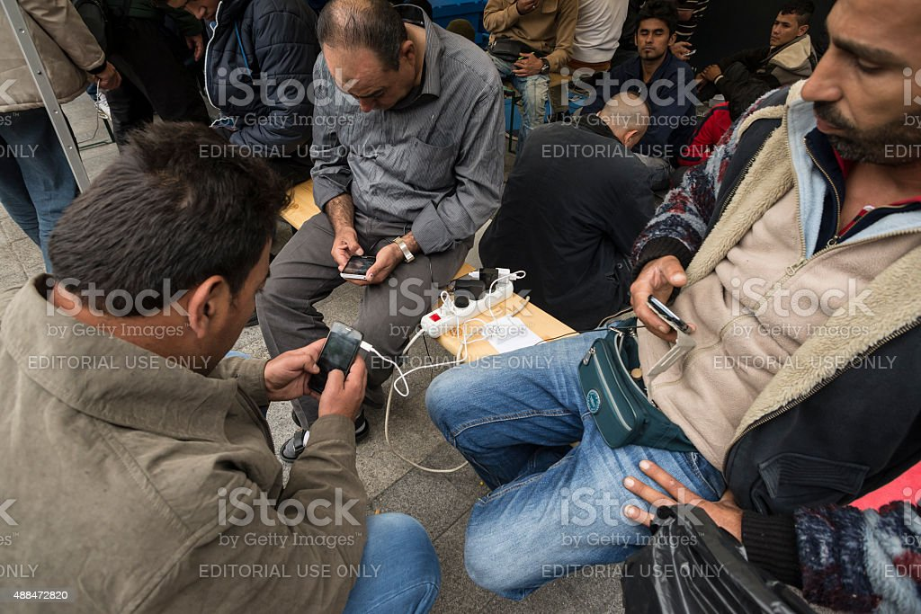 Free charge of mobil phones for refugees. stock photo