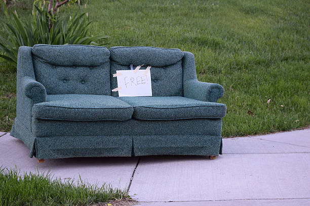 free couch on a sidewalk - dept stock pictures, royalty-free photos & images