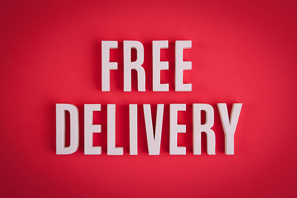 Free Delivery sign lettering stock photo