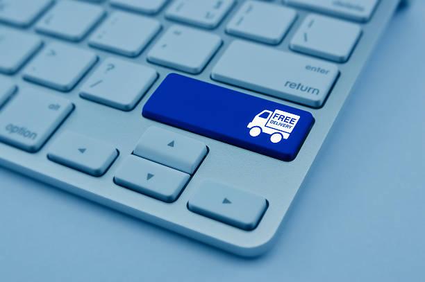 free delivery truck icon on computer keyboard button, transportation concept - kostenlose webseite stock-fotos und bilder