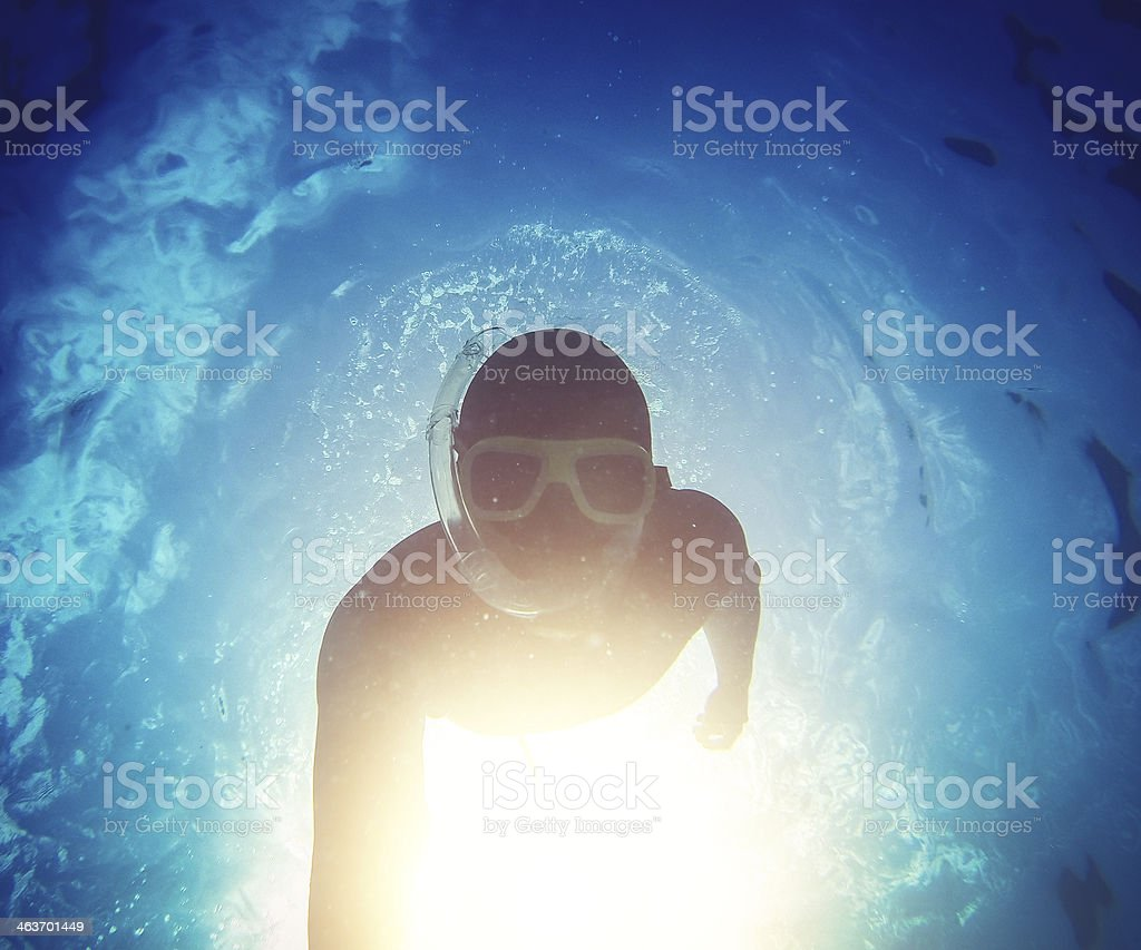 Free diver descending in the abyss royalty-free stock photo