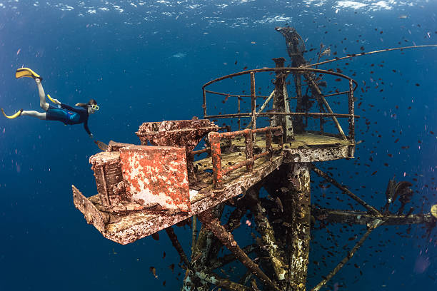 Free diver Free diver exploring the ship wreck in tropical clear sea koh chang stock pictures, royalty-free photos & images