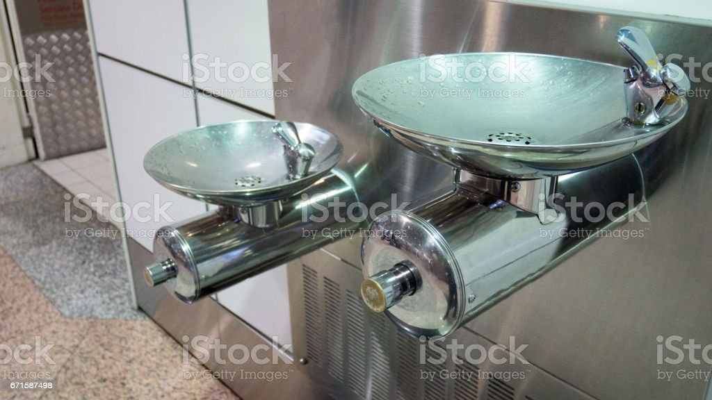 Free drinking water or drinking fountain for traveler in the departure of the airport. stock photo