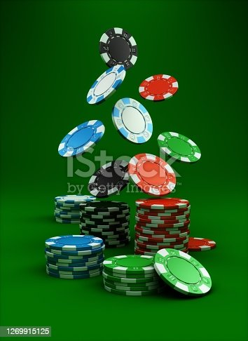 Free falling poker chips on green background