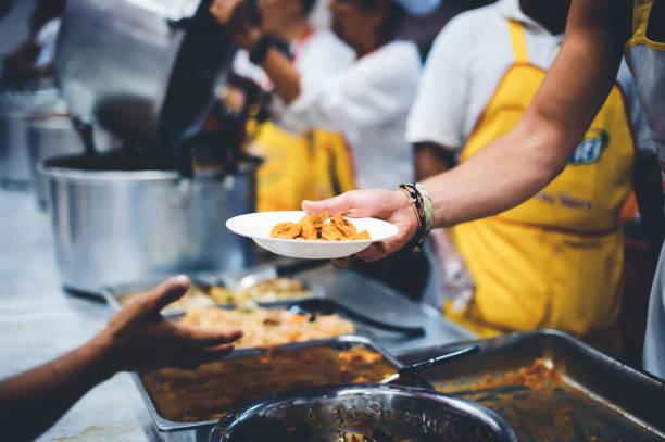 free food for the homeless and the hungry: food donation concepts - voluntário imagens e fotografias de stock