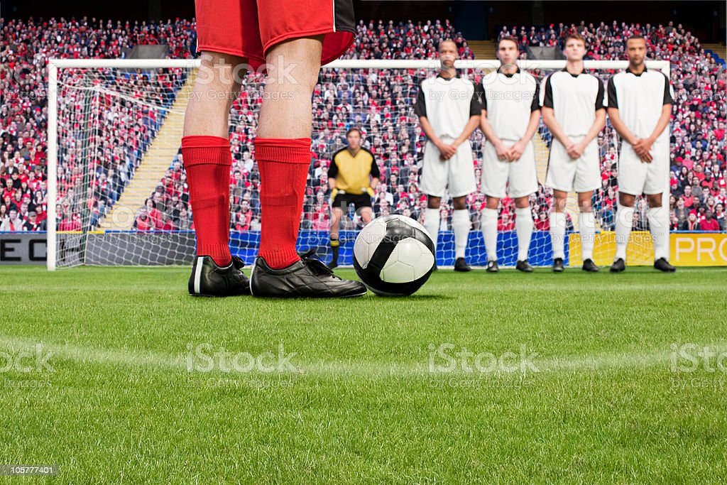 Free kick during a football match stock photo