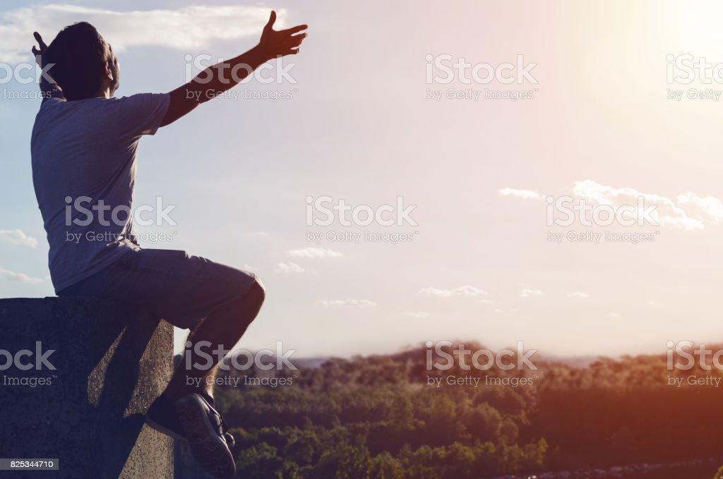 free man tranquil at sunset scene stock photo