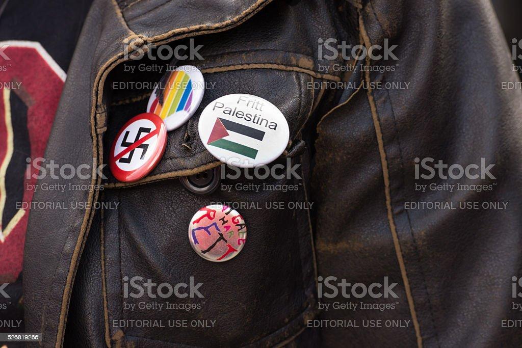 Free Palestine, LGBTQ and anti-swastika pins stock photo