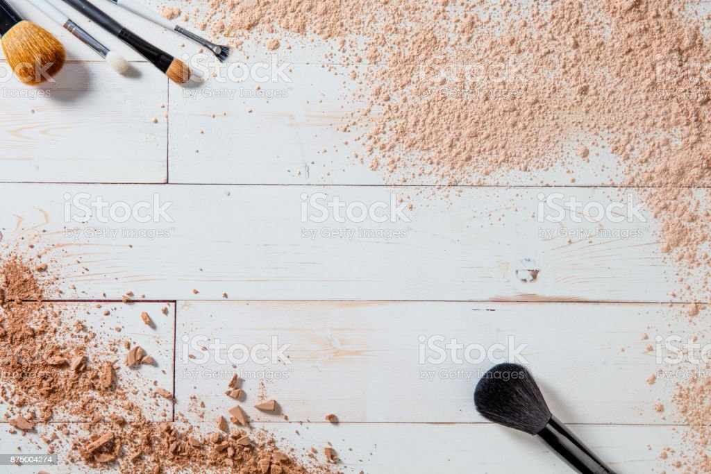 free powder and crushed minerals makeup with different brushes, wallpaper stock photo