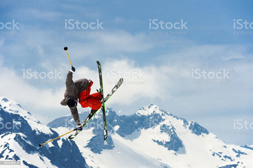 Free ride skier in mid air performing grab stock photo