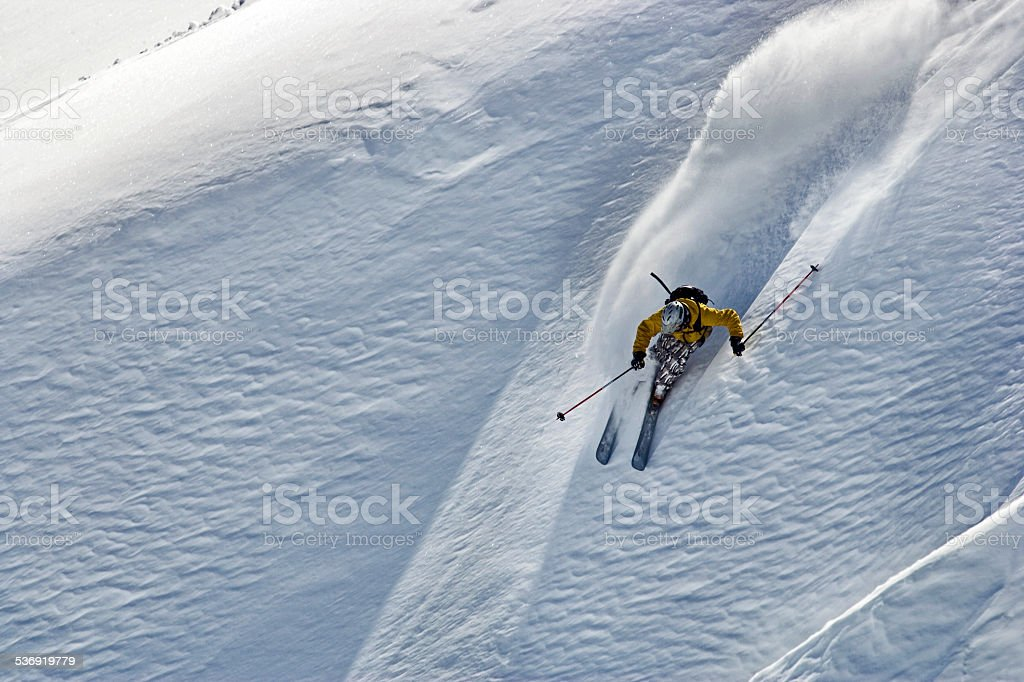 free ride skier turning in powder snow stock photo