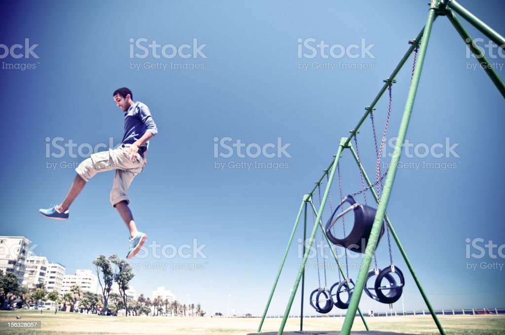 Free Runner performing a big aerial stunt in Cape Town Sea Point park...